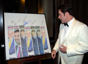 John Travolta admires Andrea Parks' art board during the 2007 Living Legends of Aviation award ceremony.