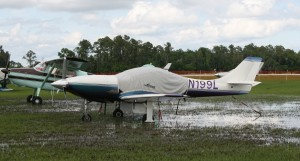 "The Lakeland area received up to four inches of rain before the start of the event. Early visitors called the event ""Rain 'n Pain"" and ""Mud 'n Scud."" As sunny weather returned and the ground began to dry, hundreds more airplanes arrived through the week."