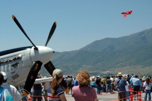 A Korean War-era Russian MiG-15 overflies a P-51 Mustang at the Heber Valley Air Show.