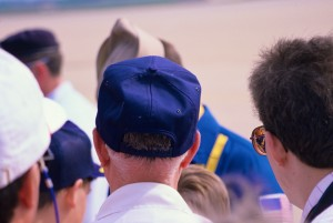 Young Brian J. Terwilliger's brown hair and blue baseball cap is all you can see of him as he awaits an autograph from the Blue Angels.