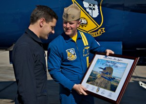 Lt. Weisser presents a signed and dated photo given to all VIP flight recipients. Brian Terwilliger said it was the most thrilling ride he ever had.