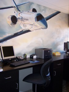 In the modern pilot's lounge, a dramatic mural of a Cessna Citation Excel, hand painted by a local artist, accents new computers and furniture.