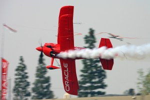 Sean D. Tucker performed one of his signature maneuvers, the triple ribbon cut.