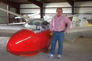 Burt Compton, next to a German-made glider, is the owner of Marfa Gliders.