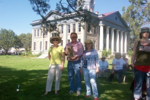 L to R: Jeanne Carpenter, Burt and Kathie Compton wait in front of the Davis County Courthouse for the July 4 parade at Ft. Davis, Texas.
