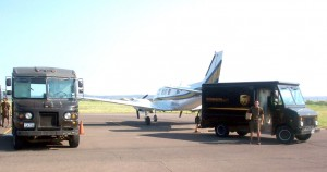 UPS trucks surround a Beechcraft Queen Air delivering packages from Dallas.