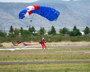 A skydiver flares his parachute for the crowd at the 2007 Big Bend Air Show.