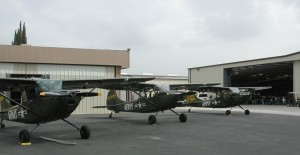 Three beautifully restored Cessna Bird Dogs flew in for the event. The L-19 in the center has some unusual equipment.