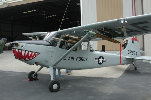 "One of the four L-19s flown in for the event has an Air Force O-1 paint scheme and has a simulated white phosphorus (""Willie Pete"") target-marking rocket mounted on a wing rack."