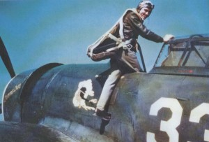 "Photographed at Republic Field in early 1943, Stan Miles climbs into Leo Northrop's P-47C, Donna Dae, for a training flight. The ""Fighting 21st"" insignia is painted on the fuselage."