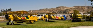 The participants' aircraft, neatly arranged prior to a morning flight, included, at right, Norman Erb's banner-towing aircraft, a Grumman G-164A Ag-Cat.