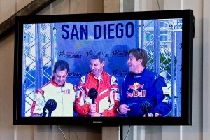 L to R: Mike Mangold, Paul Bonhomme and Kirby Chambliss joke with each other on the podium. Spectators could follow the race action on numerous television and jumbotron screens located throughout the venue.