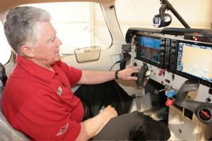Mooney sales representative Bob Shank demonstrates the Acclaim's Garmin G1000 instrument panel.