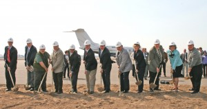 L to R: H. John Huenink, Mayor Tom Ryan, Dick Lang, Dennis Berg, Viqar Shariff, Jack Lanners, Brad Kost, Scott LeDoux, Rhonda Sivarajah, Dan Erhart, Robyn West and Hollis Cavner participated in Key Air's FBO groundbreaking at Anoka County-Blaine Airport.
