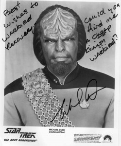 "Michael Dorn, who previously owned a CASA jet, T-33 Shooting Star and F-86 Sabre, is now looking for an F-8 Crusader. He autographed this Lt. Worf picture for Gordon Page at Warbird Recovery, asking for help finding a ""cheap Klingon warbird."""