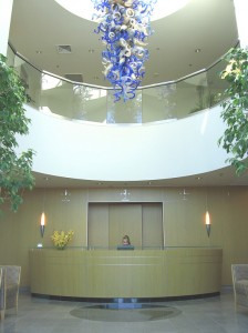 A blown-glass, Dale Chihuly chandelier welcomes visitors to Global Aviation's offices.
