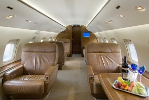 Corporate jet interiors come in a variety of styles and arrangements, including this one set up for both work and relaxation.