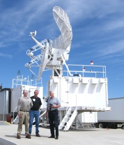 L to R: the MUTES radar antenna dwarfs ESS site manager Bill Clingenpeel, a radar technician and airspace manager Dwight Williams.