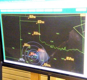This radar screen, located inside the ESS building, displays the echo returns from various military aircraft in W Texas and NM. Each blip is identified by transponder codes that give information about the plane's type, altitude, ground speed and direction