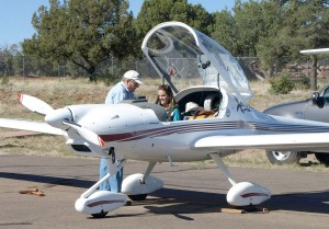 Russ Hustead instructs Miss New Mexico Teen, Kaycee McDaniel, how to buckle up in his Diamond motor glider.
