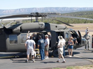 An Arizona Army National Guard officer from Aviation Unit 285 proudly points out features of the 1978 UH 60A Blackhawk helicopter.