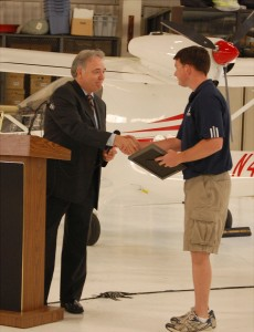 Charles Stites awards a Jet Aviation scholarship to Ryan Kelly. Kelly is the first student to attend Philly Sport Pilot, which specializes in flight training for the disabled.