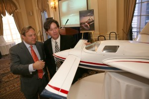 Granger Whitelaw and actor Timothy Hutton examine a scale model of the Velocity Rocket racer. Hutton is a Rocket Racing League advisory board member.