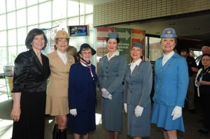 Dr. Bonnie Dunbar poses with women from World Wings, who wore vintage uniforms while greeting guests.