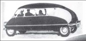 A side view of the new Stout auto, showing the beetle-shaped design and the driver's seat placed over the front axle.