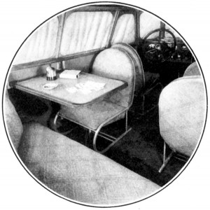 A view showing the elaborate interior of the Scarab.  In the rear are two movable chairs, a lounge, and a collapsible table.  High speed will not jar ash tray on the table.