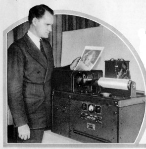 Charles J. Young shown with the new simplified device for sending photos by radio.