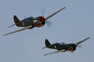 Curtiss P-40 Warhawks, piloted by Mark Moody and Jim Thomas, are another pair of aircraft that flew during the air war over the Pacific demonstration.