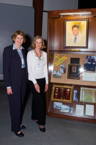 Beverly Crabtree and Barbara Upchurch, daughters of Arizona Aviation Hall of Fame member Graham Edwards, stand by his recognition wall.