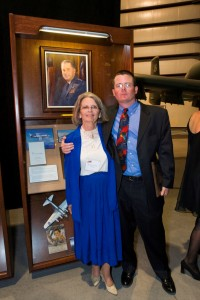 Raymonda Mackay, daughter of Gen. Hewitt Wheless, and her son Chris MacKay, by the display honoring Gen. Wheless at the Arizona Aviation Hall of Fame.