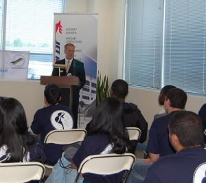Patrick Sniffen, vice president of marketing and communications for Jet Aviation, explains to the ACE campers what they can expect at Jet Aviation's FBO.
