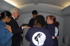 John Kelleher, assistant manager of Flight Safety's Learning Center in Teterboro, describes the inner workings of a Dassault Falcon simulator to the students.