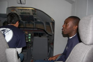 Kingsley Akunor sits in the simulator, fascinated by the description of how a simulator recreates a flight. All of the students were amazed at how the simulators can create any weather condition so realistically.
