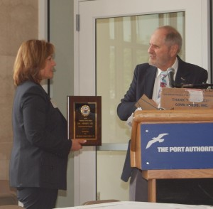 Maria Renner, security manager for Morristown Municipal Airport in Morristown, N.J, and member of the New Jersey Aviation Association Board of Directors, accepts a recognition award for NJAA's numerous flight training scholarships.