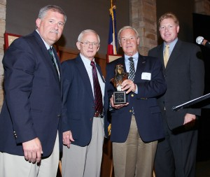 L to R: Robert Olislagers, Larry Ulrich, Jim Jeppesen and Chris Dunn. Ulrich accepted the Captain Elrey Jeppesen Award from Jeppesen, Elrey Jeppesen's son, due to his efforts to push legislation to make ELTs mandatory, saving countless lives.