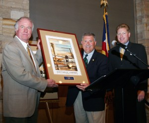 L to R: Bill Payne accepts his award from Robert Olislagers and emcee Chris Dunn, honoring his career in aerospace engineering and expansion of the safety radar system in the Rocky Mountains of Colorado.