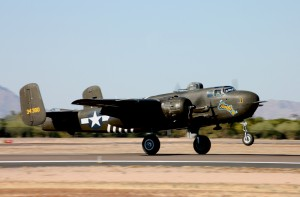 "The B-25H Mitchell bomber, operated by the Warbirds Unlimited Foundation Inc., wears the WWII nose art of Barbie III. The aircraft is one of 1000 ""H"" models built during WWII."