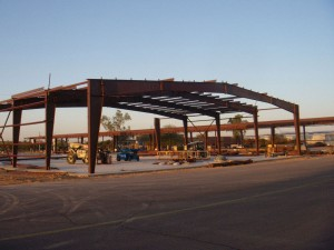 Lots of steel is being erected at Falcon Field, as Desert Jet Center's extensive hangar facilities join retail outlets and other business development at the growing airport.