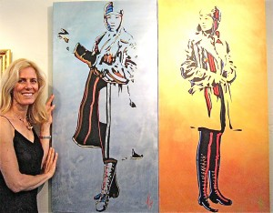 "Artist Mimi Stuart is pictured with her painting, ""Mastery: Bess Coleman Mystery: Amelia Earhart."""