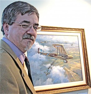 "Mike O'Neal, WWI artist and historian, shows his painting, ""Valentine's Day,"" which shows Lt. Valentine Burger downing a German ace."
