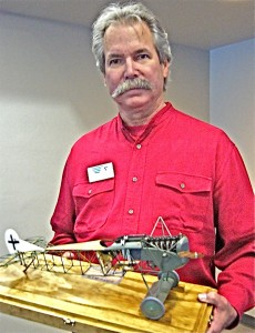 Steve Anderson holds his prize-winning model of a Fokker D.1, which depicts the construction of the aircraft and has a tiny, but remarkably detailed, engine.