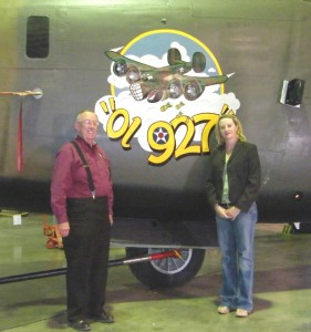 B-24 and B-29 squadron leader Lyn Fite (left) and CAF executive Wendy Stoneman pose next to Ol 927 nose art on the B-24 Liberator.