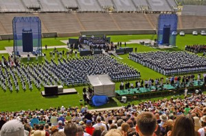 New second lieutenants file into Falcon Stadium for graduation.