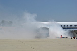 A B-727 aircraft is on fire following the simulated crash.