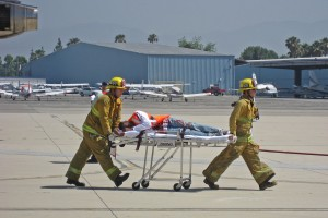 "Medical responders rush a seriously injured ""patient"" to an ambulance for transportation to a local hospital."