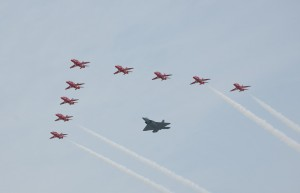 Maj. Paul Moga flies in formation in an F-22 Raptor with the Royal Air Force Aerobatic Team, the Red Arrows.